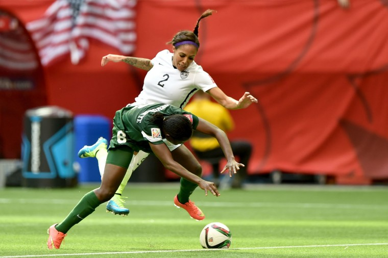 Sydney Leroux #2 of the United States is taken down by Sarah Nnodim #22 of Nigeria as Nnodim is given a red card in the second half in the Group D match of the FIFA Women's World Cup Canada 2015 at BC Place Stadium on June 16, 2015 in Vancouver, Canada. (Rich Lam/Getty Images)
