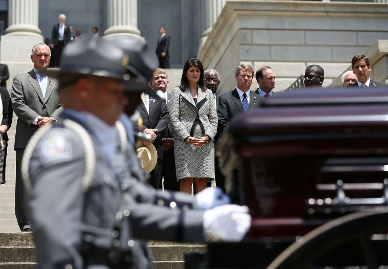 COLUMBIA, SC - JUNE 24: South Carolina Governor Nikki Haley looks on as she stands with other lawmakers as South Carolina Highway Patrol Honor Guard prepare to carry the coffin of church pastor and South Carolina State Sen. Clementa Pinckney to lie in repose at the Statehouse Rotunda on June 24, 2015 in Columbia, South Carolina. Pinckney was one of nine people killed during a Bible study inside Emanuel AME church in Charleston. U.S. President Barack Obama and Vice President Joe Biden are expected to attend the funeral which is set for Friday June 26 at the TD Arena. (Photo by Joe Raedle/Getty Images)