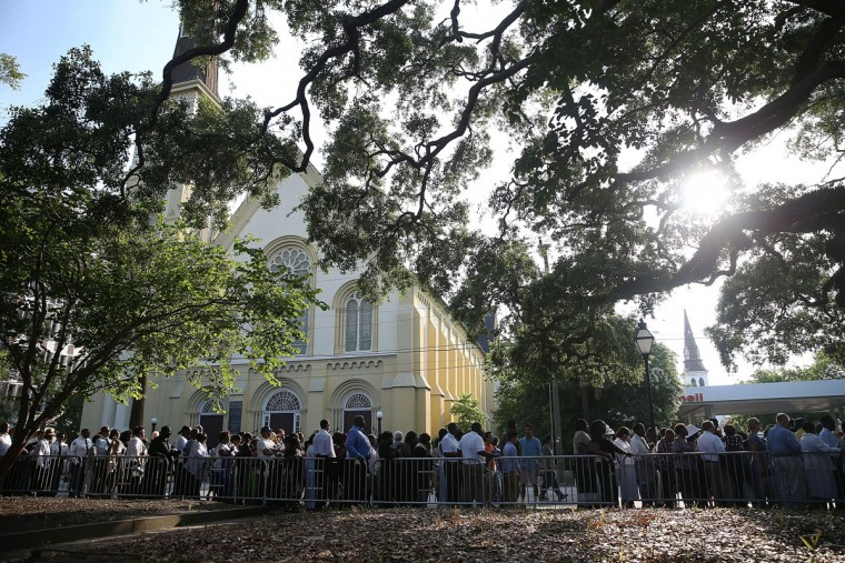 People line up to enter the College Charleston TD Arena where President Barack Obama is scheduled to deliver the eulogy for South Carolina State Sen. Clementa Pinckney who was killed during the mass shooting at the Emanuel African Methodist Episcopal Church along with eight others in a mass shooting at the church on June 25, 2015 in Charleston, South Carolina. Suspected shooter Dylann Roof, 21 years old, is accused of killing nine people on June 17th during a prayer meeting in the church, which is one of the nation's oldest black churches in Charleston. (Photo by Joe Raedle/Getty Images)