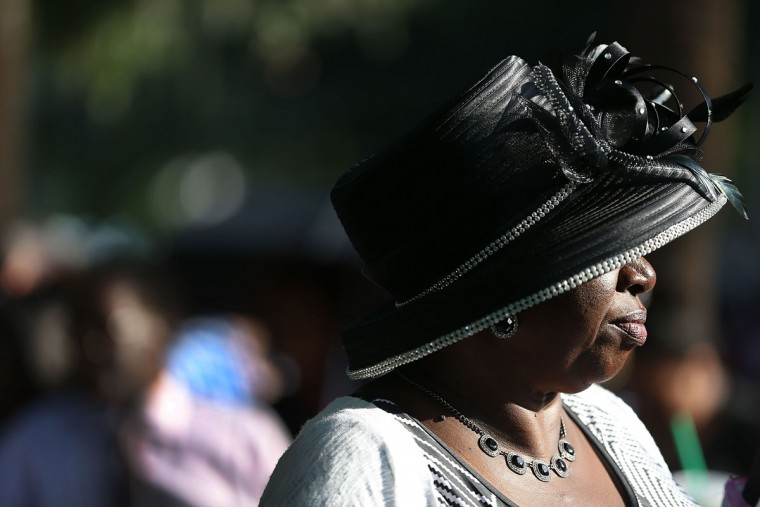 Willette Scottash and others line up to enter the College Charleston TD Arena where President Barack Obama is scheduled to deliver the eulogy for South Carolina State Sen. Clementa Pinckney who was killed during the mass shooting at the Emanuel African Methodist Episcopal Church along with eight others in a mass shooting at the church on June 26, 2015 in Charleston, South Carolina. Suspected shooter Dylann Roof, 21 years old, is accused of killing nine people on June 17th during a prayer meeting in the church, which is one of the nation's oldest black churches in Charleston. (Photo by Joe Raedle/Getty Images)
