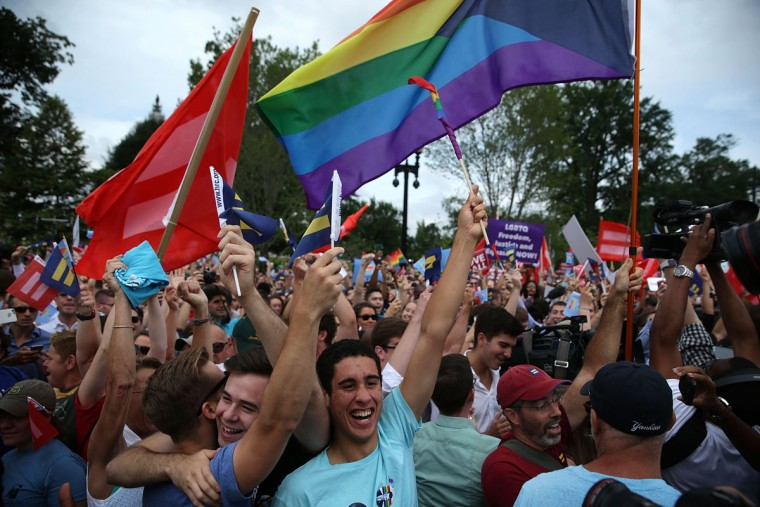 Same-sex marriage supporters rejoice after the U.S Supreme Court hands down a ruling regarding same-sex marriage June 26, 2015 outside the Supreme Court in Washington, DC. The high court ruled that same-sex couples have the right to marry in all 50 states. (Photo by Alex Wong/Getty Images)