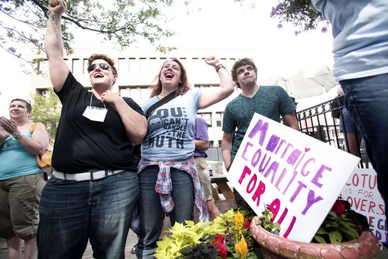 Same-sex marriage supporters rejoice after the U.S Supreme Court hands down a ruling regarding same-sex marriage on June 26th, 2015 in Ann Arbor, Michigan. The U.S. Supreme Court ruled that same-sex couples have the right to marry in all 50 states. (Photo by Bill Pugliano/Getty Images)