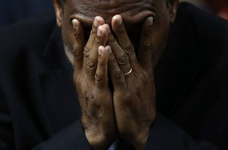 Mourners bow their heads in prayer during the funeral service where U.S. President Barack Obama delivered the eulogy for South Carolina State senator and Rev. Clementa Pinckney who was killed along with eight others in a mass shooting June 26, 2015 in Charleston, South Carolina. Suspected shooter Dylann Roof, 21, is accused of killing nine people on June 17th during a prayer meeting in the church, which is one of the nation's oldest black churches in Charleston. (Photo by Win McNamee/Getty Images)