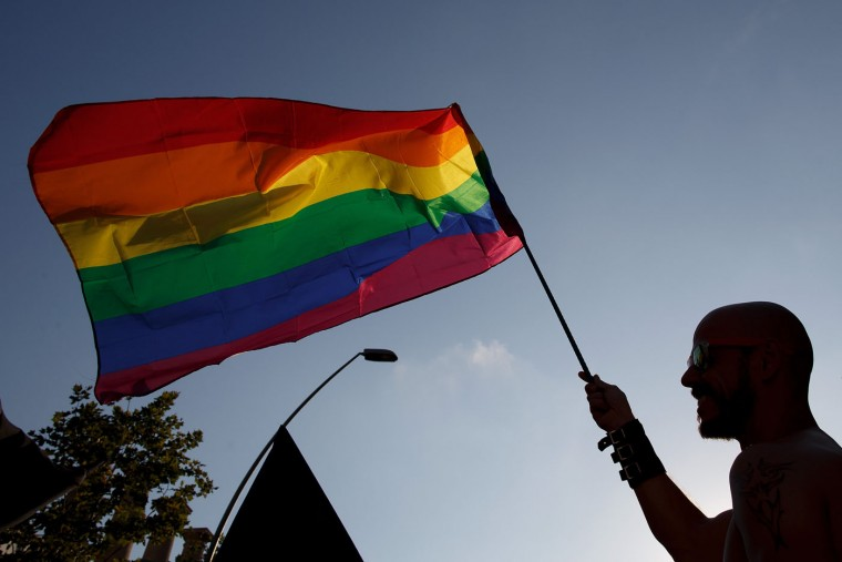 A reveller waves a pride flag during the annual Pride Parade on June 27, 2015 in Barcelona, Spain. Gay parade marches are taking place in at different places around the world to commemorate the start of the gay rights movement. (Pablo Blazquez Dominguez/Getty Images)