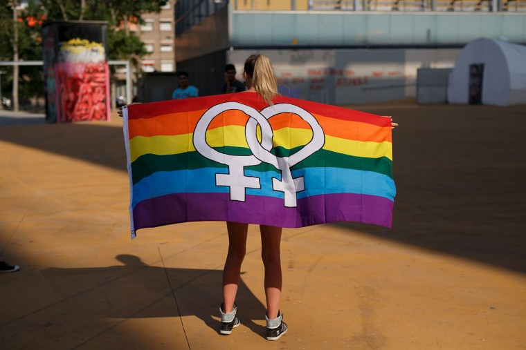 A reveller holds a pride flag during the annual Pride Parade on June 27, 2015 in Barcelona, Spain. Gay parade marches are taking place in at different places around the world to commemorate the start of the gay rights movement. (Pablo Blazquez Dominguez/Getty Images)