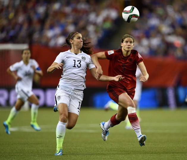 Alex Morgan of the United States and Annike Krahn of Germany battle for the ball in the FIFA Women's World Cup 2015 Semi-Final Match at Olympic Stadium on June 30, 2015 in Montreal, Canada. (Dennis Grombkowski/Bongarts/Getty Images)