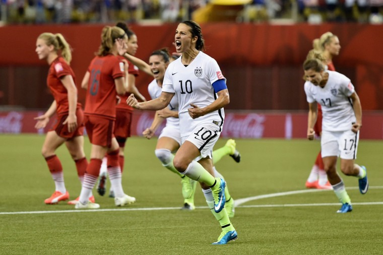 Carli Lloyd of Germany celebrates as she scores the opening goal from a penalty in the FIFA Women's World Cup 2015 Semi-Final Match at Olympic Stadium on June 30, 2015 in Montreal, Canada. (Dennis Grombkowski/Bongarts/Getty Images)