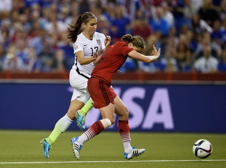 Annike Krahn of Germany blocks Alex Morgan of the United States in the FIFA Women's World Cup 2015 Semi-Final Match at Olympic Stadium on June 30, 2015 in Montreal, Canada. (Dennis Grombkowski/Bongarts/Getty Images)