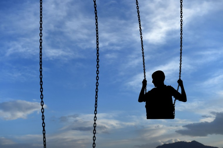 An Afghan boy plays on a swing at a fair in a field near the Sahki Shrine in Kabul on May 31, 2015. Despite massive injections of foreign aid since the fall of the Taliban in 2001, Afghanistan remains desperately poor as it attempts to recover from decades of conflict. (AFP Photo/Farshad Usyan)