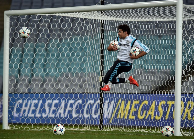 Chelsea's striker Diego Costa kicks a ball during a football training session in Sydney on June 1, 2015. The English Premier League champions take on local team Sydney FC in a friendly exhibition match on June 2. (AFP Photo/Saeed --image restricted to editorial use - strictly no commercial use--saeed khan)