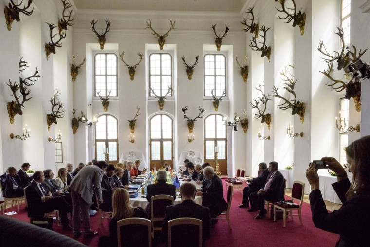 The participants of a two-day meeting of Interior ministers of socalled G6 group sit around the table at the Moritzburg Castle near Dresden, eastern Germany on June 1, 2015. The interior ministers from Germany, France, Italy, Poland, Spain and the UK meet there for discussions, focusing on organized crime, on refugee policy, Islamist terrorism and cyber crime. (AFP Photo/Jens Schlueter)