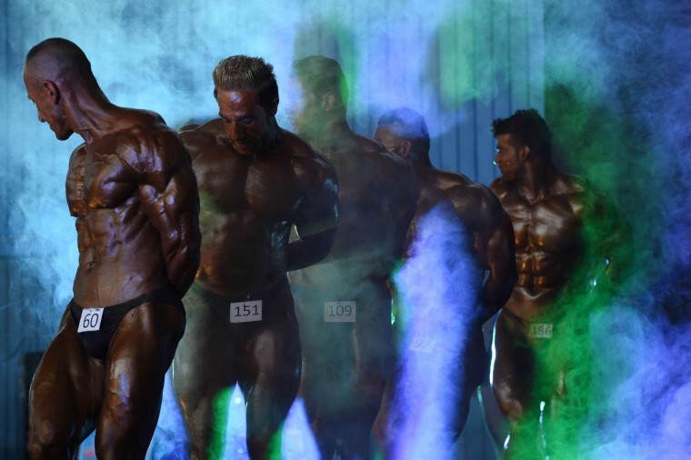 Afghan bodybuilders participate in the Mr Afghanistan nation wide bodybuilding competition in Kabul. Bodybuilding is one of the country's most popular sports, even permitted during the 1996-2001 Taliban regime. (Shah Marai/Getty Images)