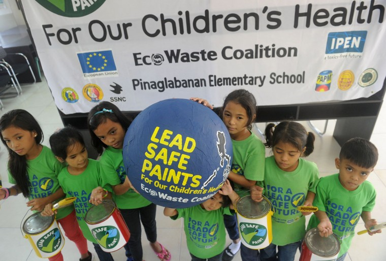 Children pose during a briefing as advocates for children's health gather at a government public school in Manila on June 4, 2015 to mark the World Environment Day, with a common plea for paint companies to accelerate the removal of lead, a brain-damaging toxic chemical, as 2016 phase-out deadline for leaded decorative paint approaches. Environmentalist EcoWast Coalition says that eliminating lead paint in the market will contribute to reducing children's exposure to lead in paint and dust and promote a conducive environment for children to safely live, grow, learn and play. (AFP Photo/Jay Directo)