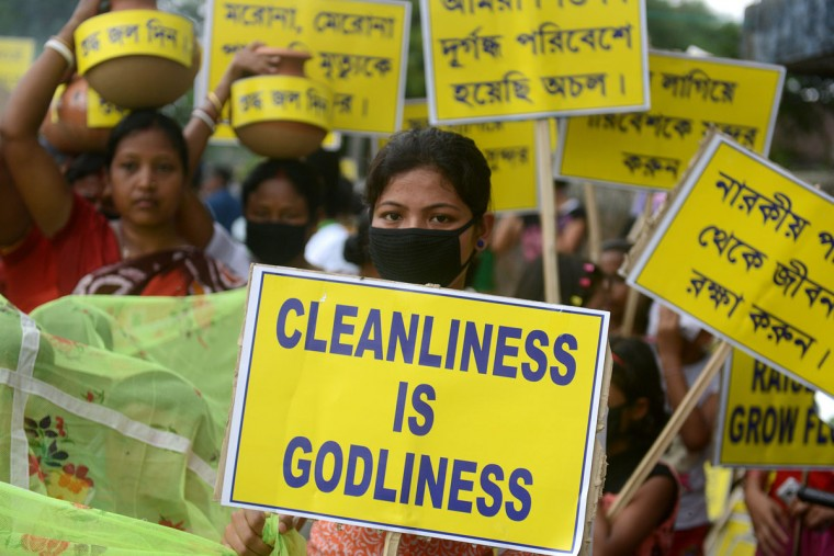 Indian activists carry placards during an environment awareness campaign in Siliguri on June 5, 2015, on the occasion of World Environment Day. Social activists, along with school children, took part in the rally to raise awareness of the environment, as well as the use of mosquito nets and fresh drinking water. (AFP Photo/P / )