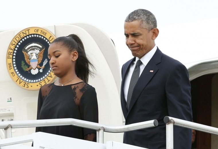 US President Barack Obama walks with his daughter Sasha as he arrives at Delaware Air National Guard, Delaware, on June 6, 2015. The first family will attend services honoring Beau Biden at St. Anthony of Padua R.C. Church. Obama will deliver the eulogy for Vice President Joe Biden's son Beau, who lost his battle with brain cancer at age 46. (Yuri Gripas/AFP/Getty Images)
