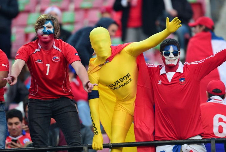 Supporters of Chile and Ecuador cheer for their teams at the Nacional stadium in Santiago hours before the Copa America inauguration match Chile vs Ecuador, on June 11, 2015. (AFP Photo/Martin Bernetti)