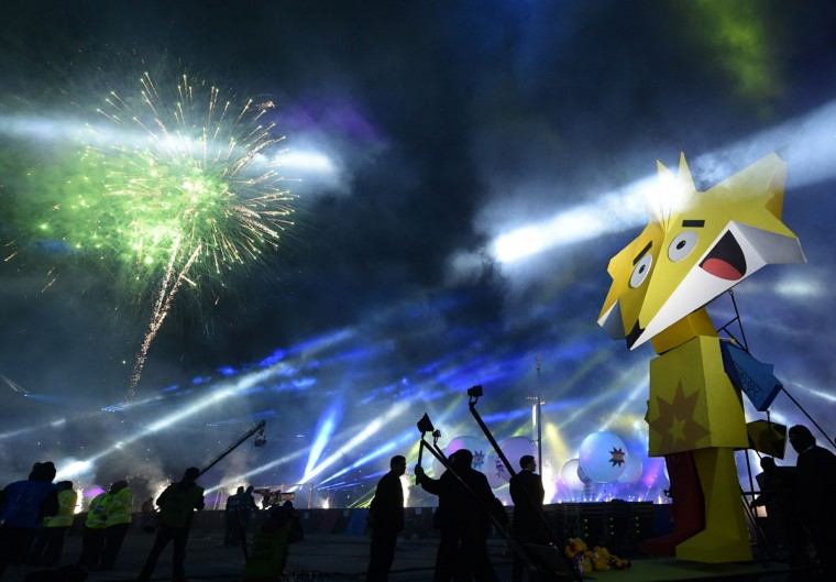 Fireworks and lights are seen during the Copa America inauguration ceremony at the Nacional stadium in Santiago, on June 11, 2015. Chile will face Ecuador in the inauguration match. (AFP Photo/Luis Acosta)