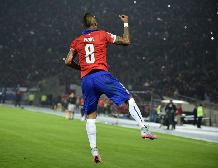 Chile's midfielder Arturo Vidal celebrates after scoring a penaly kick against Ecuador during the Copa America inauguration football match at the Nacional stadium in Santiago, on June 11, 2015. (AFP Photo/Luis Acosta)