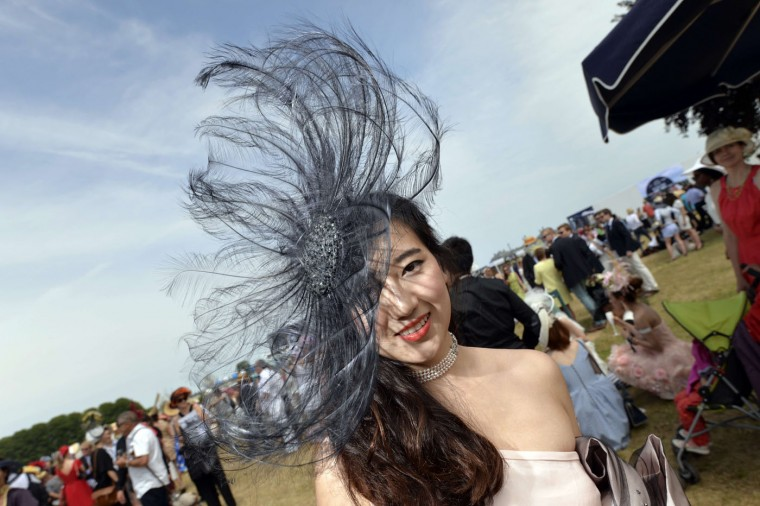A woman wearing a hat poses during the 166th Prix de Diane, a 2100-metre flat horse race open to three-year-old thoroughbred fillies, on June 14, 2015 in Chantilly, outside Paris. (Miguel Medina/AFP/Getty Images)