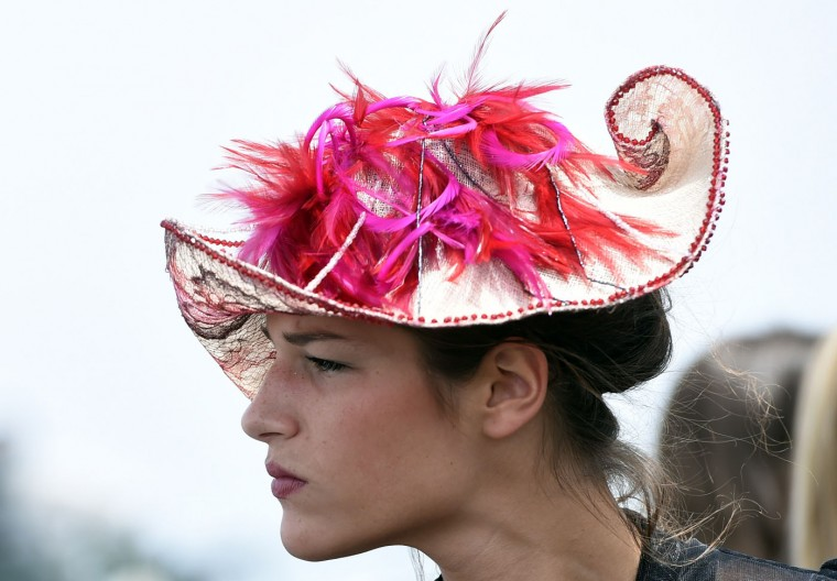 A woman wearing a hat attends the 166th Prix de Diane, a 2100-metre flat horse race open to three-year-old thoroughbred fillies, on June 14, 2015 in Chantilly, outside Paris. (Miguel Medina/AFP/Getty Images)