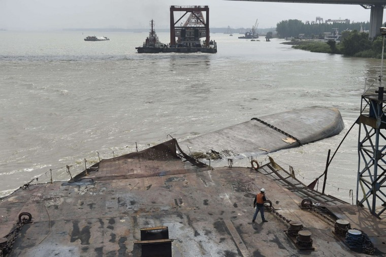 A rescue worker (bottom center right) walks towards a Chinese cargo ship after it capsized on the Yangtze river near the eastern city of Nanjing in east China's Jiangsu province on June 18, 2015, with casualties remaining unknown, according to state media. (AFP/Getty Images)