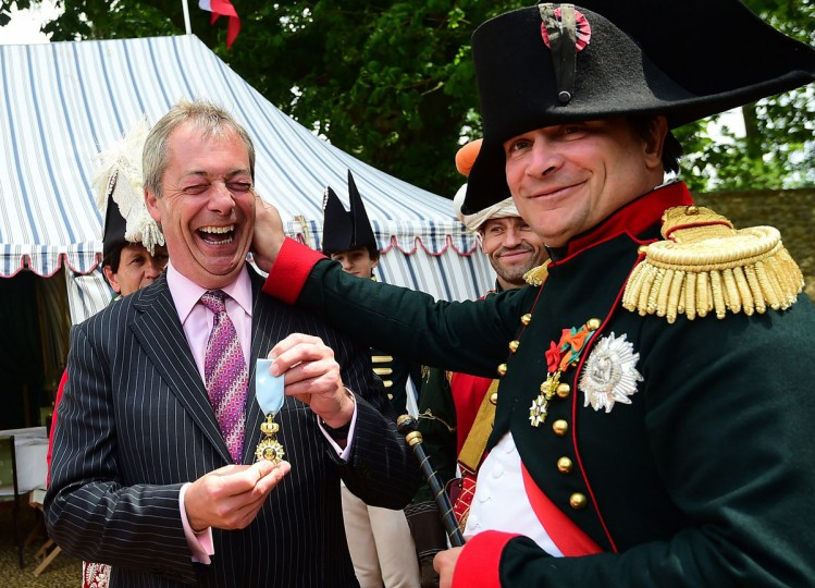 French lawyer Franck Samson, dressed as Napoleon Bonaparte (right) pulls the ear of UK Independence Party leader Nigel Farage at Napoleon Bonaparte headquarters during the celebrations of the 200th anniversary of The Battle of Waterloo in Waterloo, on June 18, 2015. (EMMANUEL DUNAND/AFP/Getty Images)