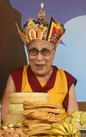 Tibetan Spiritual leader the Dalai Lama wears a Nyingma - one of the five traditional schools of Tibetan Buddhism - hat during an event to celebrate his 80th birthday at Tsuglakhang Temple in McLeod Ganj on June 22, 2015. The Dalai Lama marked his official 80th birthday on June 21, with prayers and celebrations at his hometown in exile but little to show for decades of lobbying for greater Tibetan autonomy. (AFP Photo/Narinder Nanu)