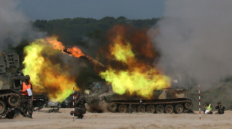 South Korean army's K-55 self-propelled howitzer fires during a live-fire exercise to mark the 65th anniversary of the outbreak of the1950-53 Korean War at a training ground in the border county of Cheorwon on June 24, 2015. (YONHAP/AFP/Getty Images)