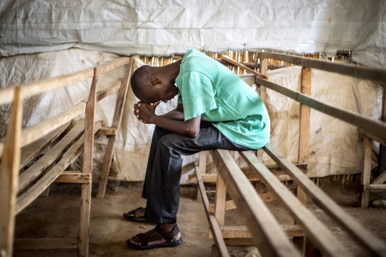 A Christian worshipper prays at a church in the flashpoint neighborhood of Musaga in Bujumbura on June 24, 2015. (MARCO LONGARI/AFP/Getty Images)