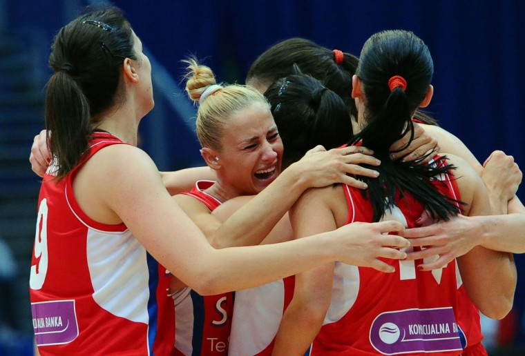 Serbia's players celebrate their victory over Turkey after the quarterfinals basketball match between Turkey and Serbia at the EuroBasket Women 2015 tournament in Budapest on June 24, 2015. (ATTILA KISBENEDEK/AFP/Getty Images)