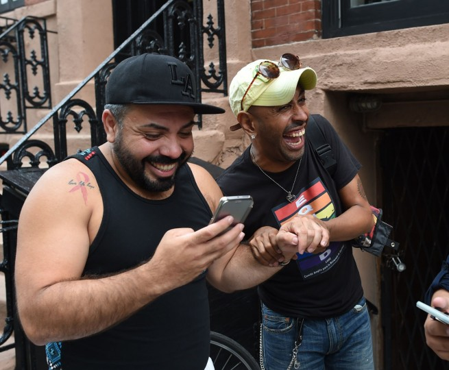 People celebrate outside the Stonewall Tavern in the West Village in New York on June 26, 2015. The US Supreme Court ruled Friday that gay marriage is a nationwide right, a landmark decision in one of the most keenly awaited announcements in decades and sparking scenes of jubilation. The nation's highest court, in a narrow 5-4 decision, said the US Constitution requires all states to carry out and recognize marriage between people of the same sex. (AFP Photo/ a. clarytimothy a. clary)