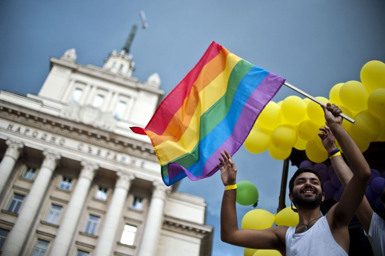 A man waves the Rainbow flag on a truck during the annual Gay Pride parade in central Sofia on June 27, 2015, as people march through the Bulgarian capital to protest discrimination against gays, lesbians and transsexuals and improve their integration in society. (Nikolay Doychinov/AFP/Getty Images)