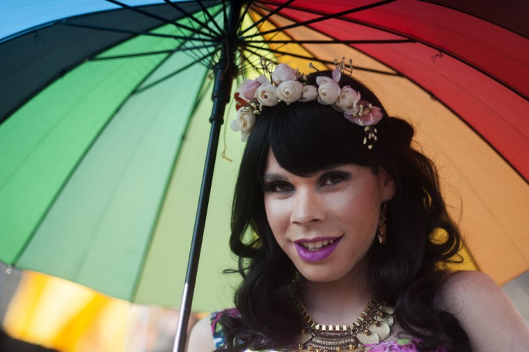 "A reveler takes part in the ""Proud to be yourself"" gay pride parade in Santiago on June 27, 2015. (Vladimir Rodas/AFP/Getty Images)"
