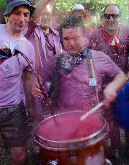 "Revelers pour red wine on a drum during the ""Batalla del Vino"" (Battle of Wine) in Haro, on June 29, 2015. (CESAR MANSO/AFP/Getty Images)"