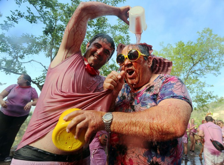 """Revellers pour wine on each other during the""""Batalla del Vino"""" (Battle of Wine) in Haro, on June 29, 2015. (CESAR MANSO/AFP/Getty Images)"""