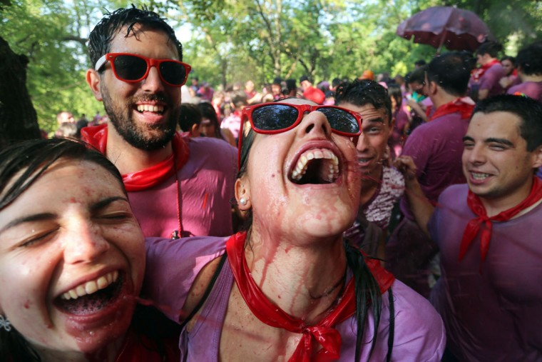 """Two girls drink wine as they enjoy the""""Batalla del Vino"""" (Battle of Wine) in Haro, on June 29, 2015. (CESAR MANSO/AFP/Getty Images)"""
