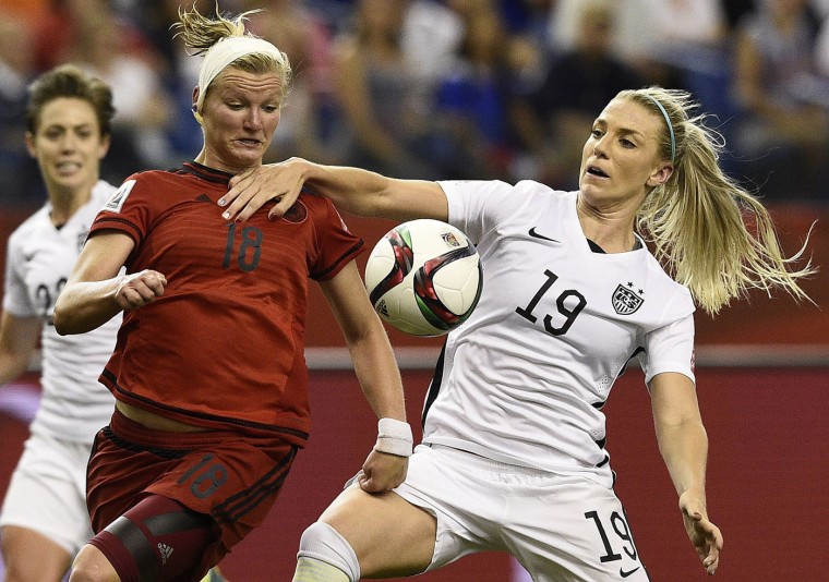 Germany's forward Alexandra Popp (L) vies with USA defender Julie Johnston during their 2015 FIFA Women's World Cup semi-final football match between USA and Germany at the Olympic Stadium in Montreal on June 30, 2015. (Franck Fife/AFP/Getty Images)