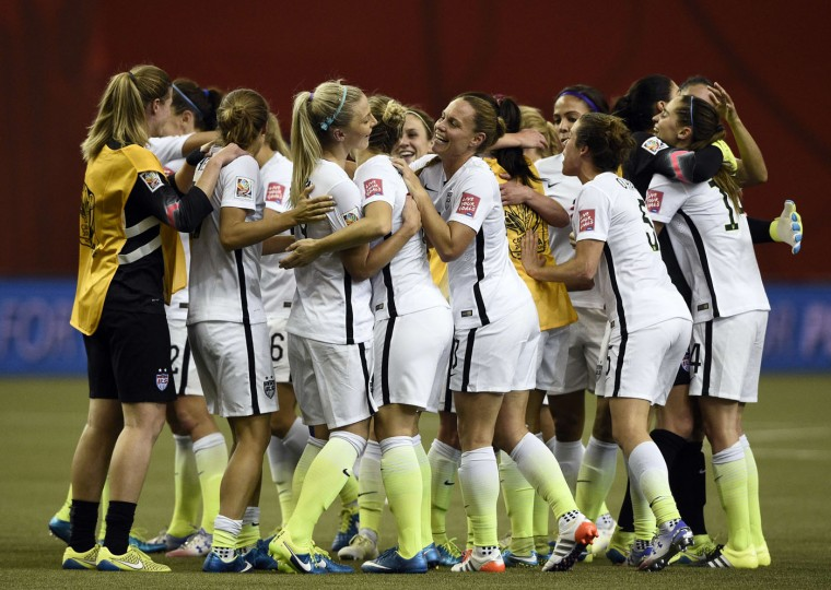 USA players celebrate after winning the semi-final football match between USA and Germany during their 2015 FIFA Women's World Cup at the Olympic Stadium in Montreal on June 30, 2015. (Franck Fife/AFP/Getty Images)