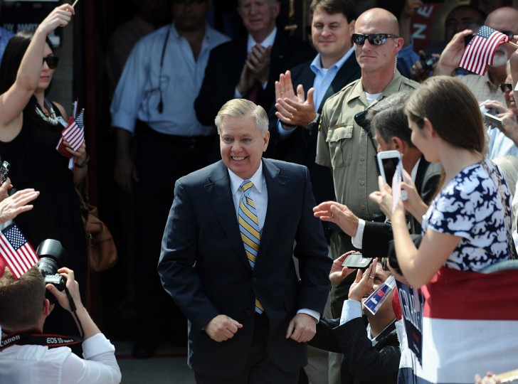 """Sen. Lindsey Graham, R-S.C. arrives to announce his bid for the presidency, Monday, June 1, 2015, in Central, S.C. Graham opened his campaign for the Republican presidential nomination Monday with a grim accounting of """"radical Islam ... running wild"""" in a world imperiled also by Iran's nuclear ambitions. (AP Photo/Rainier Ehrhardt)"""