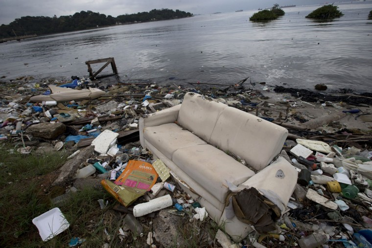 A sofa litters Guanabara Bay along with other trash in Rio de Janeiro, Brazil, Monday, June 1, 2015. Art students at a Rio de Janeiro university have taken advantage of a material they have in endless supply _ trash _ to create an exhibition that aims to draw attention to the fetid state of the city's Guanabara Bay, where the Olympic sailing events are to be held next year. (AP Photo/Silvia Izquierdo)