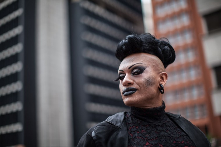 A reveler poses during the annual Gay Pride Parade in Sao Paulo, Brazil, Sunday, June 7, 2015. Hundreds of thousands gather every year on skyscraper-lined Avenida Paulista in Sao Paulo for one of the world's largest gay pride parades. (AP Photo/Andre Lessa)