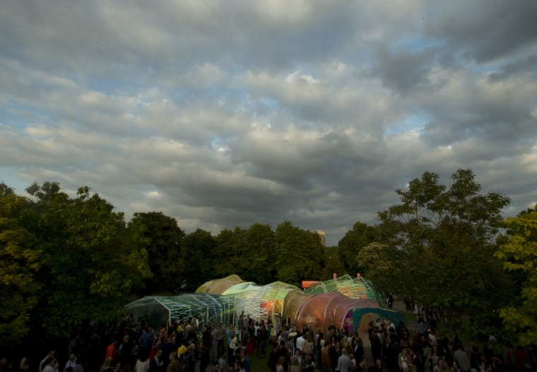 Invited guests surround the Serpentine Pavilion 2015, in Hyde park London, Tuesday, June 23, 2015. Designed by Spanish architect group Selgascano- which was formed in 1998 by Jose Selgas and Lucia Cano, the pavilion is open to the public from June 25 to October 18. The architects' work is characterized by the use of synthetic materials and new technologies, with their belief that architecture is secondary to nature. (AP Photo/Alastair Grant)