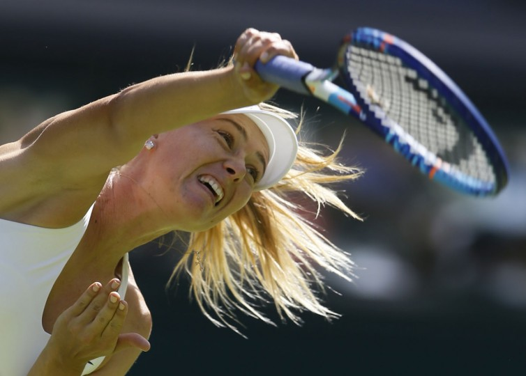 Maria Sharapova of Russia serves to Johanna Konta of Britain during the women's singles first round match at the All England Lawn Tennis Championships in Wimbledon, London, Monday June 29, 2015. (AP Photo/Tim Ireland)