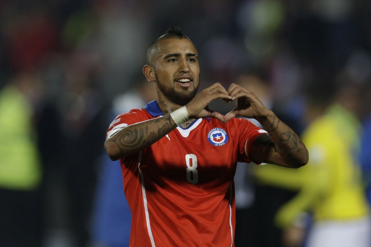 Chile's Arturo Vidal celebrates after scoring a penalty kick against Ecuador during a Copa America Group 1 soccer match at the National Stadium in Santiago, Chile, Thursday, June 11, 2015. Chile won the match 2-0. (AP Photo/Natacha Pisarenko)
