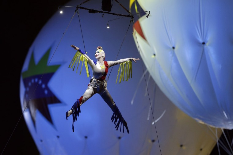 An acrobat performs during the opening ceremony of the Copa America tournament at the National Stadium in Santiago, Chile, Thursday, June 11, 2015.(AP Photo/Ricardo Mazalan)