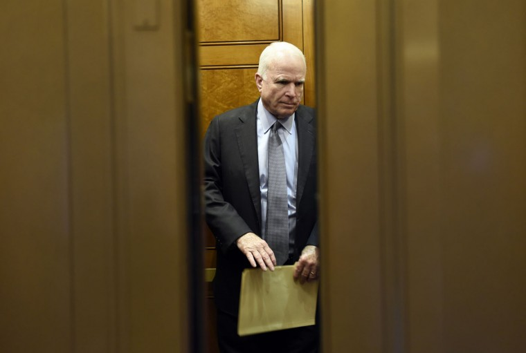 Senate Armed Services Committee Chairman Sen. John McCain, R-Ariz., gets on an elevator after being on the Senate floor on Capitol Hill in Washington, Thursday, June 4, 2015, to vote on amendments to the annual defense authorization bill. The GOP-led Senate plowed ahead Wednesday on a $612 billion annual defense policy bill despite a White House veto threat and the Democratic leader's claim that it is an exercise in futility. (AP Photo/Susan Walsh)