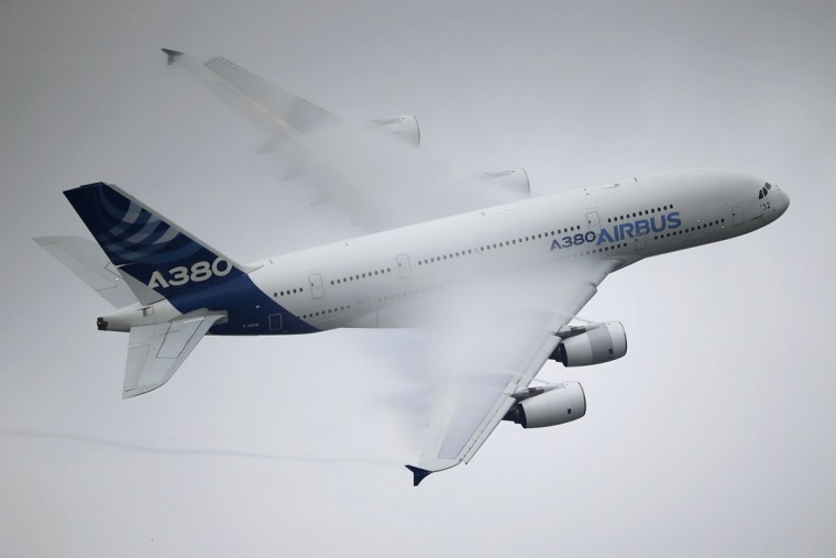 Vapour flows across the wings of an Airbus A380 as it performs its demonstration flight at the Paris Air Show, in Le Bourget airport, north of Paris, Thursday, June 18, 2015. Some 300,000 aviation professionals and spectators are expected at this weekís Paris Air Show, coming from around the world to make business deals and see dramatic displays of aeronautic prowess and the latest air and space technology. (AP Photo/Francois Mori)