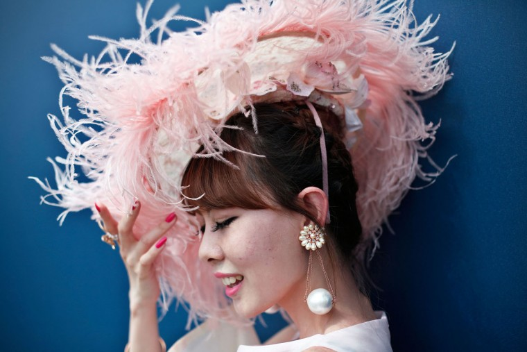 A spectator displays her hat prior to the Prix de Diane horse race, a 2100-metre flat horse race open to fillies, in Chantilly, north of Paris, France, Sunday, June 14, 2015. (AP Photo/Thibault Camus)