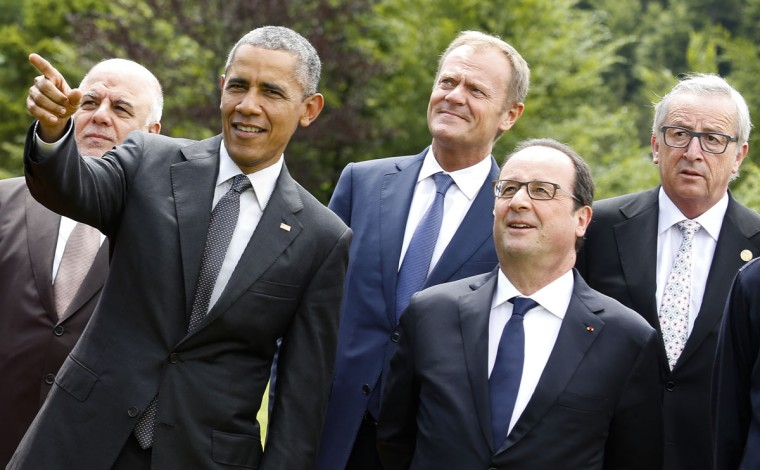 U.S. President Barack Obama, second left, points during a group photo of G-7 leaders and Outreach guests at the G-7 summit at Schloss Elmau hotel near Garmisch-Partenkirchen, southern Germany, Monday, June 8, 2015. Other leaders from left, Iraq's Prime Minister Haider al-Abadi, European Council President Donald Tusk, French President Francois Hollande and European Commission President Jean-Claude Juncker. (AP Photo/Markus Schreiber)