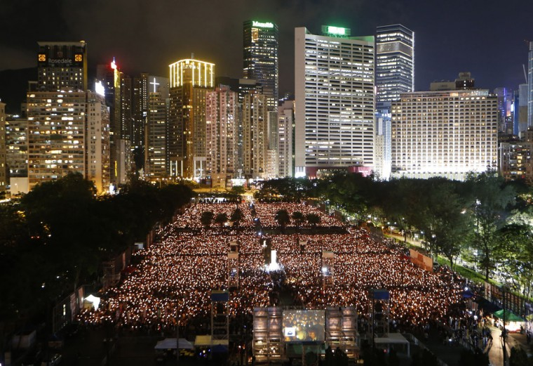 Tens of thousands of people attend a candlelight vigil at Victoria Park in Hong Kong, Thursday, June 4, 2015. Hong Kongers joined the candlelight vigil Thursday night marking the 1989 student-led Tiananmen Square protests, an annual commemoration that takes on greater meaning for the city's youth after last autumn's pro-democracy demonstrations sharpened their sense of unease with Beijing. (AP Photo/Kin Cheung)